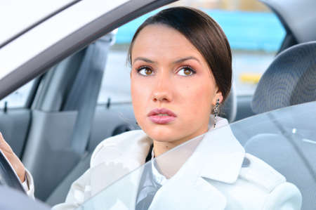 woman in a car is looking upwards photo