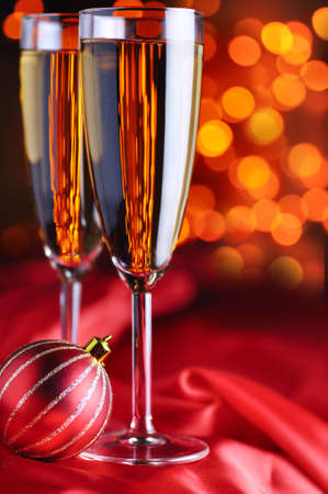two champagne glasses on red silk photo