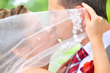 just married couple is kissing photo
