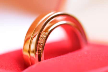 closeup of an open wedding rings box photo
