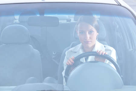 auto glass: beautiful woman is sitting in her car