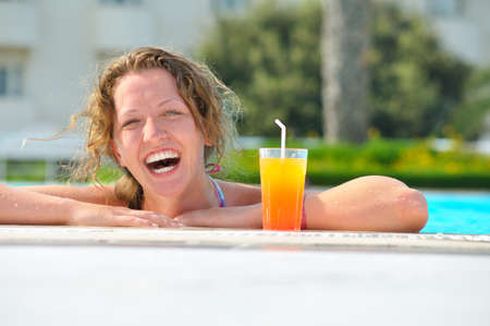 attractive woman is smiling from swimming pool in resort  Stock Photo - 8407558