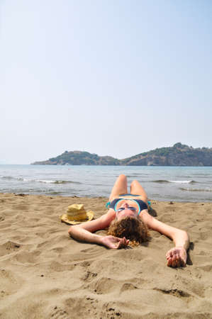 sexy woman is lying on the beach  photo