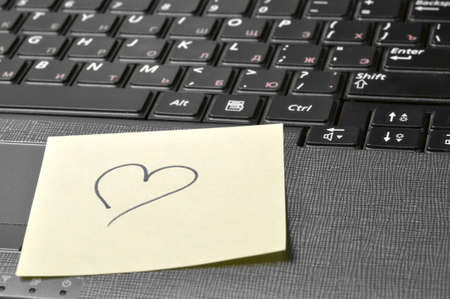 computer keyboard with heart on sticky note Stock Photo - 8650438