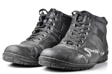 reagents: winter boots damaged by reagents Stock Photo