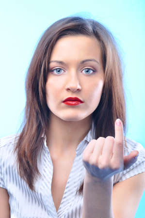 beckon: sexy long haired business woman with deep red lips is looking at camera and beckoning