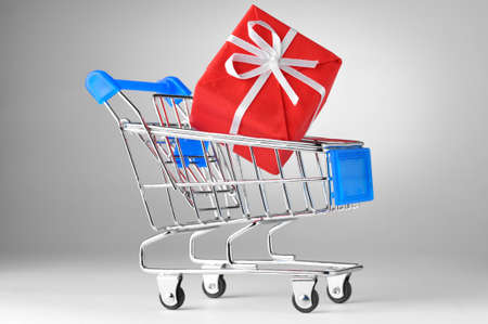 closeup of a shopping cart with gift Stock Photo - 8705328