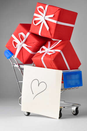 closeup of a shopping cart with gifts and heart Stock Photo - 8705332