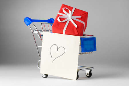 closeup of a shopping cart with gifts and heart Stock Photo - 8856914