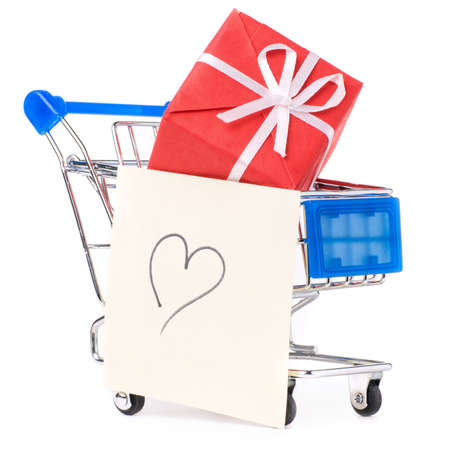closeup of a shopping cart with gifts and heart Stock Photo - 8856715