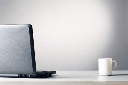 laptop with white cup Stock Photo - 8942593