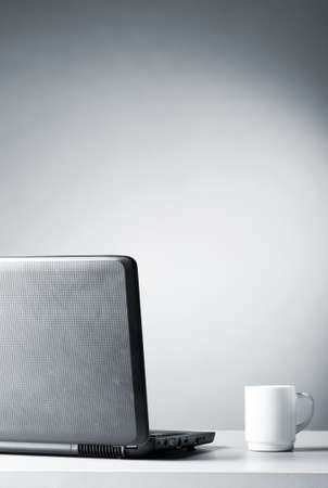 laptop with white cup Stock Photo - 8942633