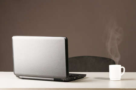 laptop with white cup Stock Photo - 8942632