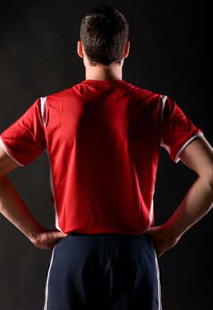jerseys: soccer player in dark
