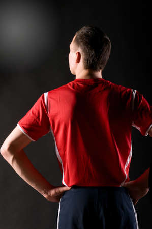 personnes de dos: joueur de soccer dans dark