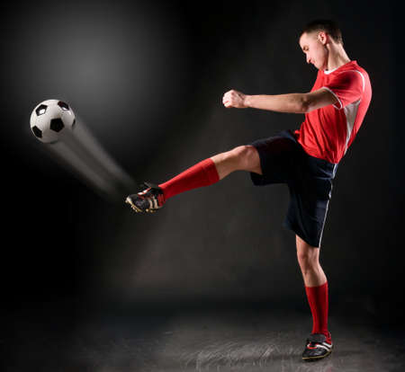 soccer player strikes photo