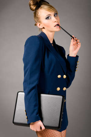 blue grey coat: sexy business woman Stock Photo