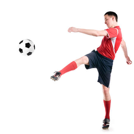 soccer player hits the ball photo