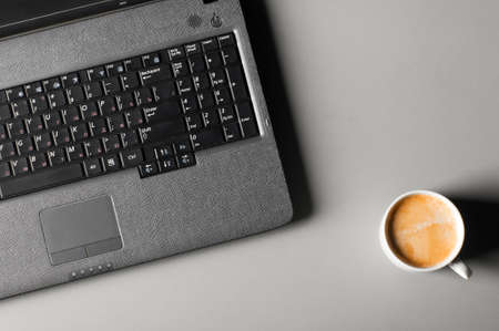 laptop with cup of coffee photo