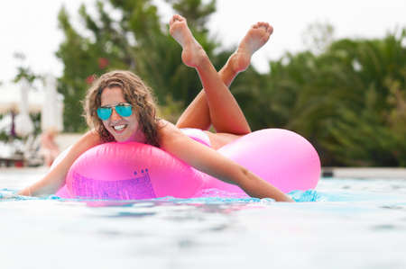 woman on pink air bed photo