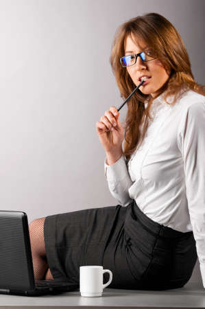 woman at office with laptop photo