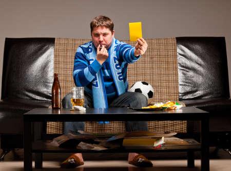 soccer fan on sofa photo