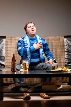 hymn: soccer fan on sofa