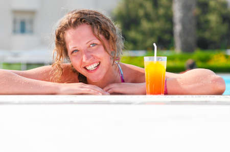 woman at poolside photo