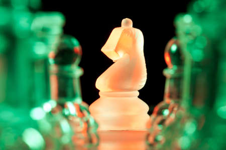 red and green glass chess pieces photo