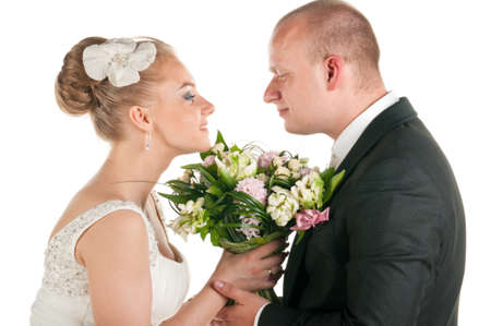 wedding couple are holding bridal bouquet photo
