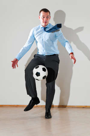 businessman is playing football Stock Photo - 9756272