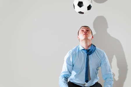 office break: businessman is playing football