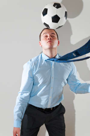 businessman is playing football photo