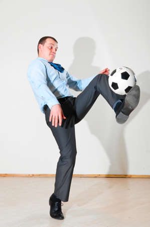 businessman is playing football Stock Photo - 9756434