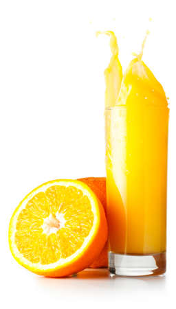 orange juice is splashing in glass cut out from white background photo
