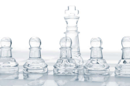 row of pawns are defending king, cut out from white photo