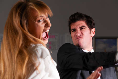 angry businessman is slapping across the businesswomans face photo
