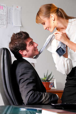 businesswoman is seducing her boss at office Stock Photo - 9756327