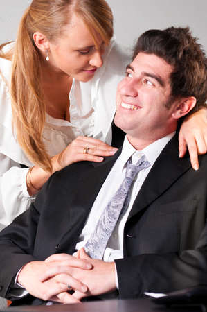 businesswoman is embracing her teammate trying to flirt with him Stock Photo - 9756330