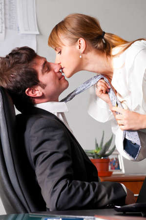 businesswoman is seducing her boss at office Stock Photo