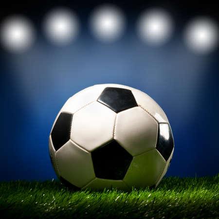 football ball is lying on grass on field at stadium Stock Photo