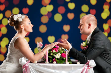 bride and groom are sitting at cafe photo