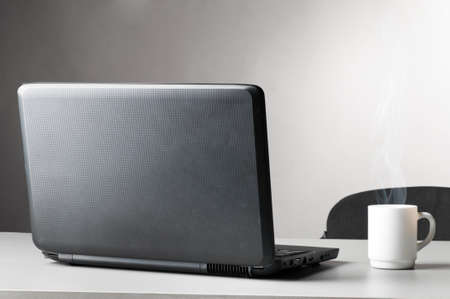 laptop with white cup Stock Photo - 9862877