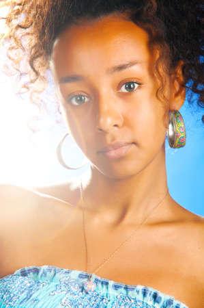 sunny beautiful mulatto woman photo