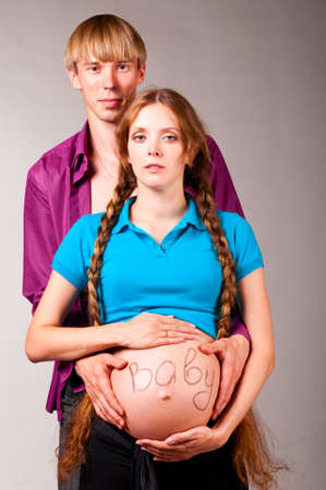 caption: pregnant couple