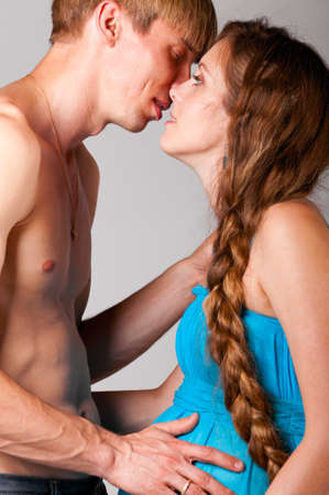man is kissing pregnant woman Stock Photo - 10305292