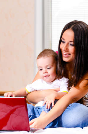 mother and son are using laptop photo