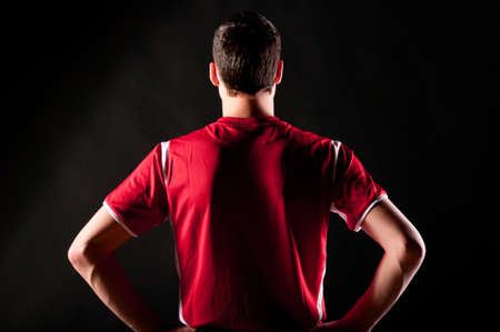 red shirt: soccer player