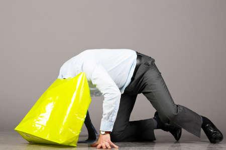 kneel: looking into green bag Stock Photo