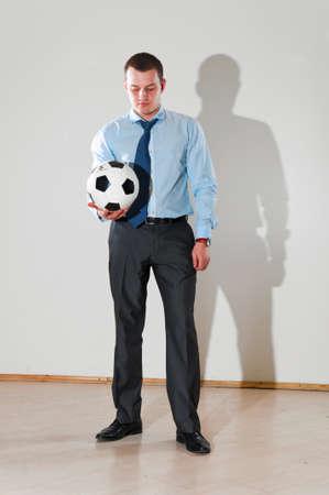 playing football at office photo